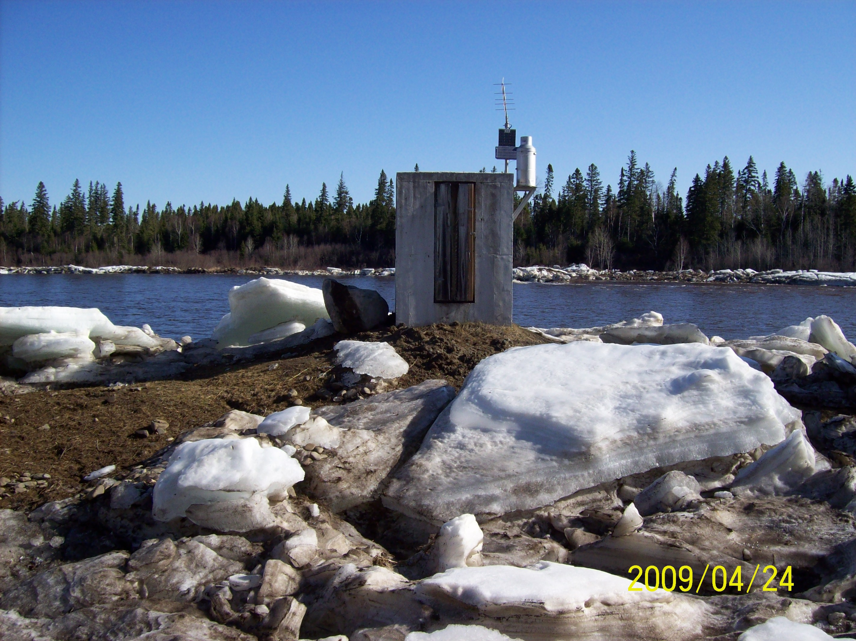 The gage house surrounded by ice chunks in late April.
